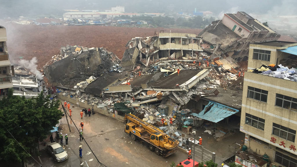 Rescuers work on the collapsed factory buildings in Shenzhen, China.