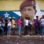 A mural of Venezuelan's late President Hugo Chavez decorates a wall o