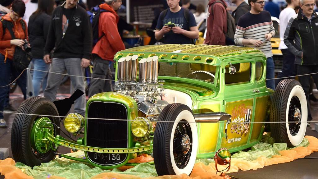 Visitors marvel at a custom-built Ford A Coupe at the Motor Show in t