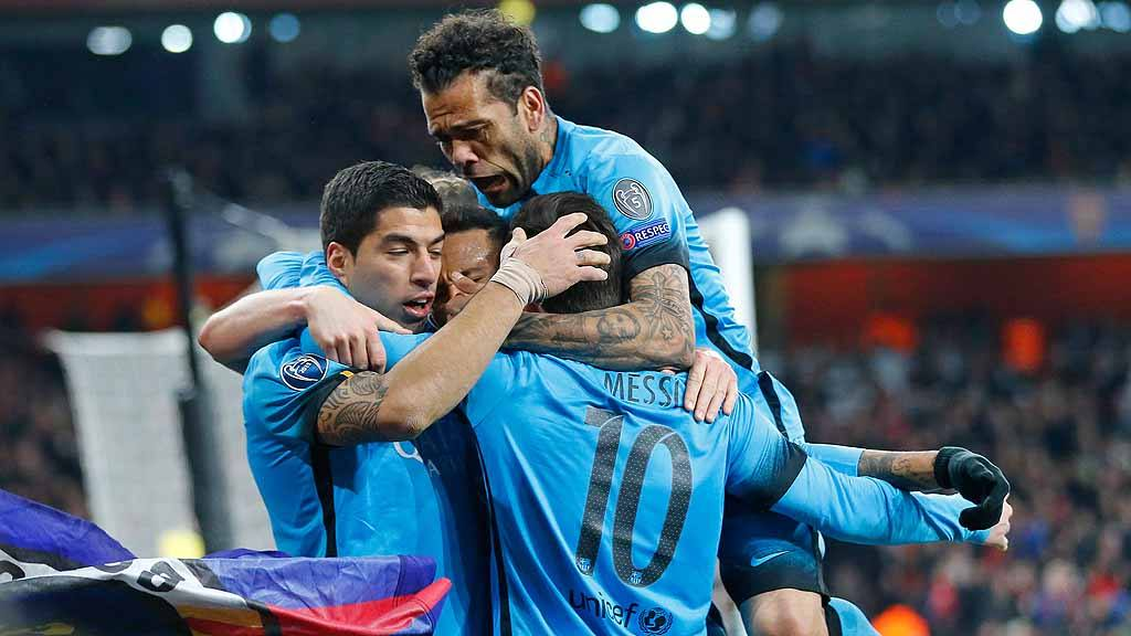Barcelona players celebrate after Lionel Messi scored the opening goa