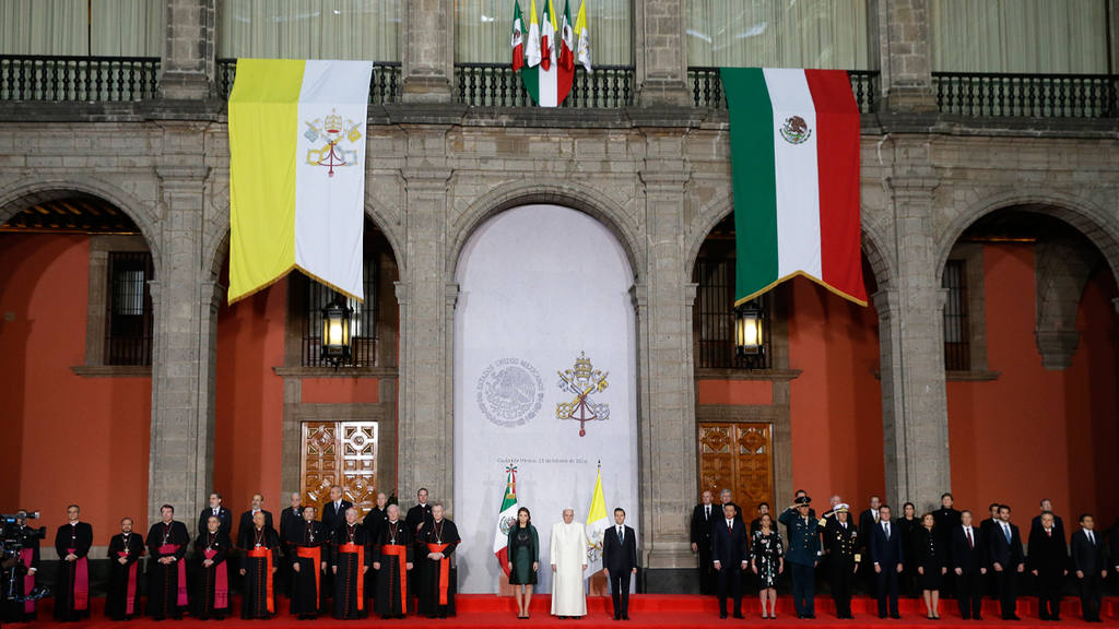 Pope Francis, center