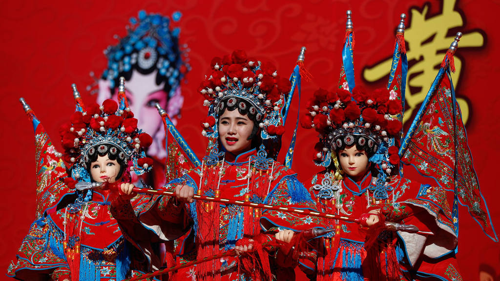 A Chinese dancer dressed in traditional costume perform a cultural da