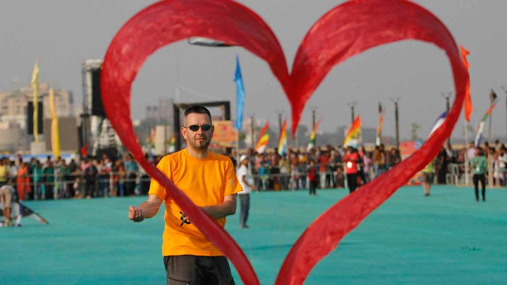 A kite flyer from Switzerland flies his heart shaped kite during inte