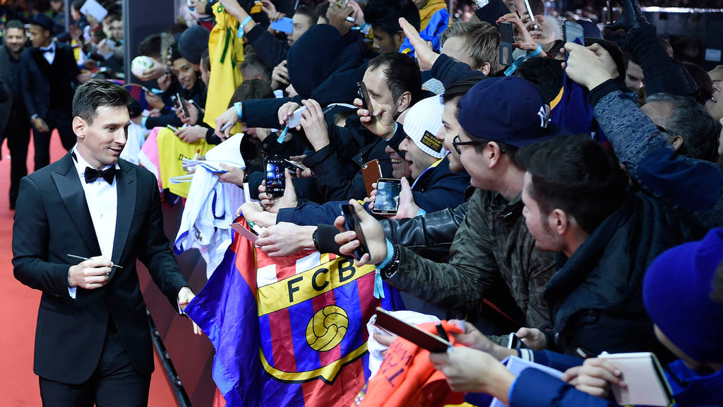 Argentina's Lionel Messi signs autographs on the red carpet prior to