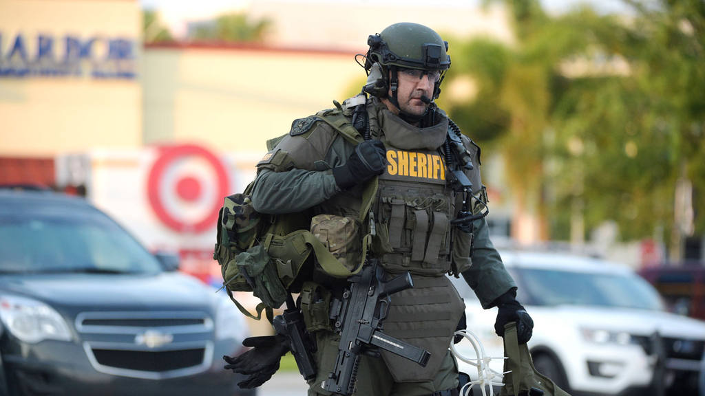 An Orange County Sheriff's Department SWAT member arrives to the scen