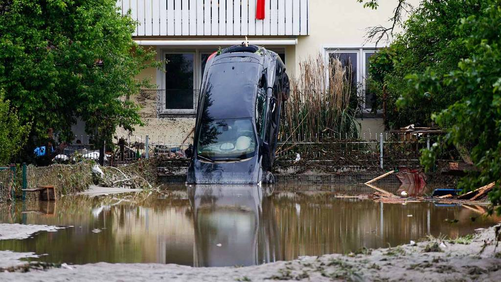 A car lies in mud after the small town was hit by flooding in Simbach