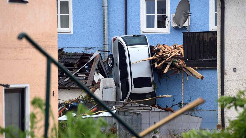 In this June 1, 2016 photo a car is squeezed between houses of Simbac