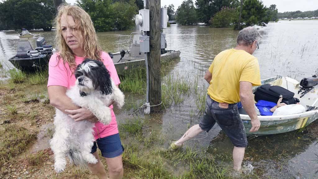 Luisiana busca a sus vivos y muertos por inundaciones