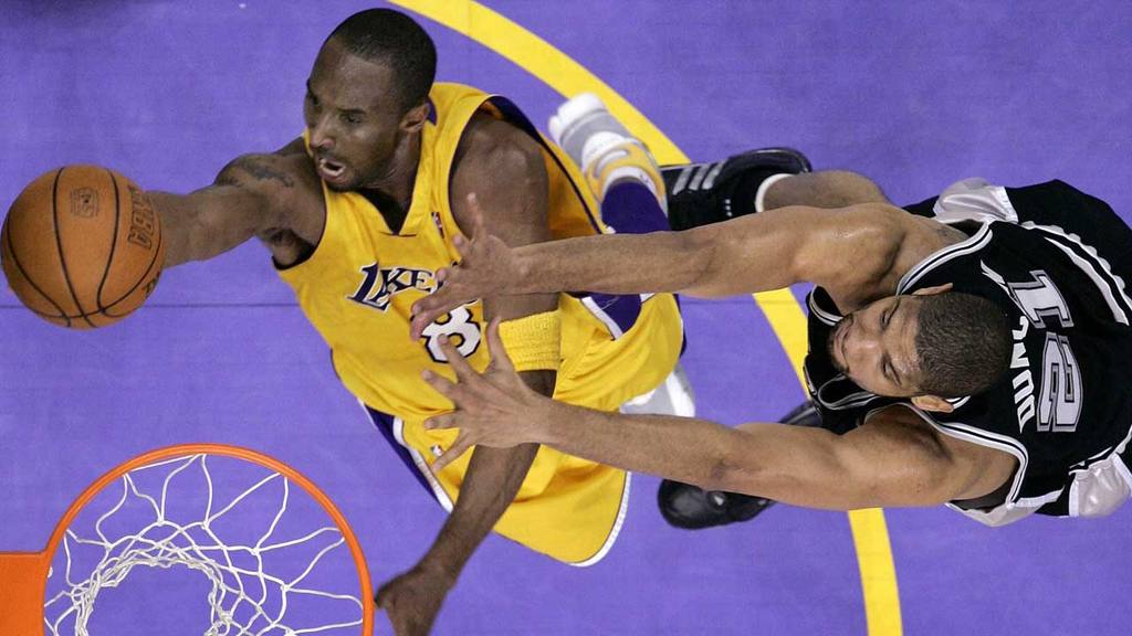 Los Angeles Lakers Kobe Bryant goes up for a shot past San Antonio Spurs Tim Duncan in Los Angeles