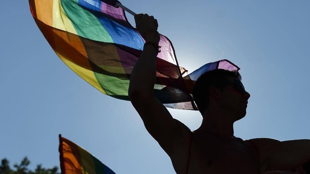 Participants wave flags and dance during the Gay Pride parade in Madr
