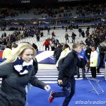 Spectators invade the pitch of the Stade de France stadium after the