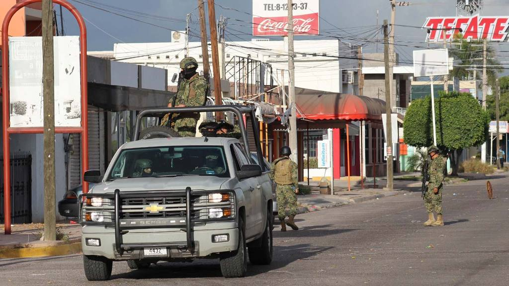 Mexican Navy marines secure a street after the recapture of Mexico's