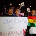Demonstrators shout slogans against Bolivian President Evo Morales