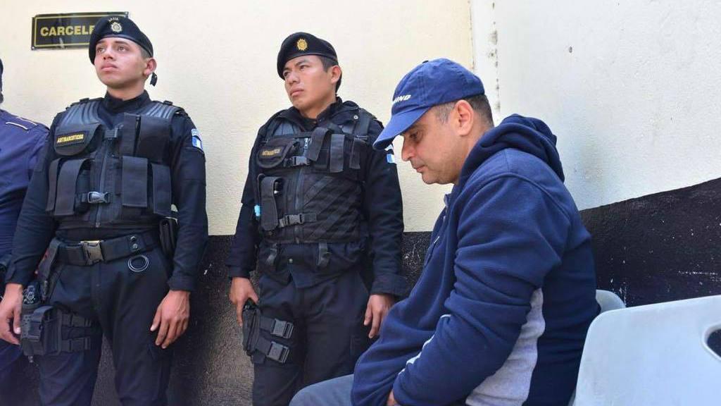 El detenido Mario Baldetti (der).