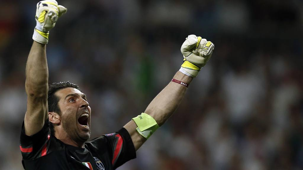 Juventus goalkeeper Gianluigi Buffon celebrates after his teammate Al