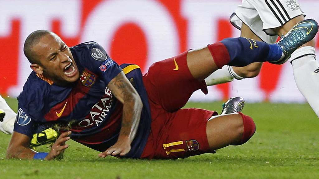 Barcelona's Neymar grimaces as he falls during a Champions League Gro