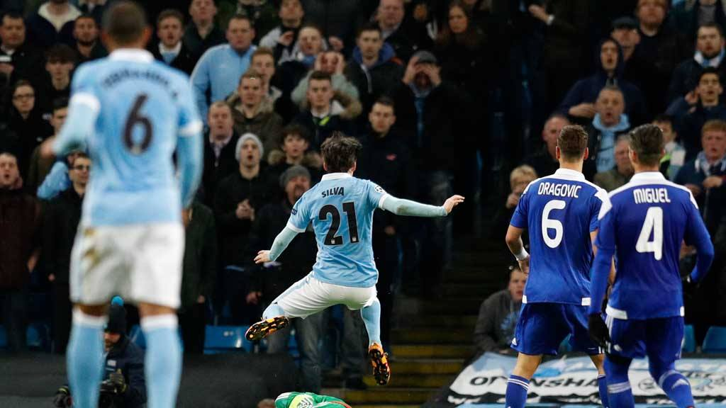 Manchester City's David Silva leaps over Kiev's goalkeeper Oleksandr