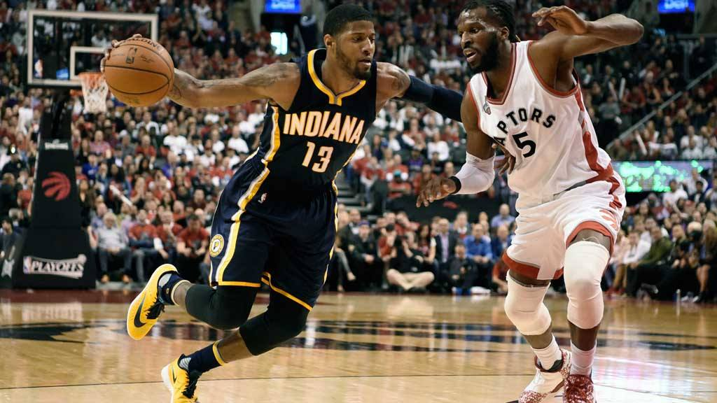 Indiana Pacers' Paul George (13) drives to the basket as Toronto Rapt