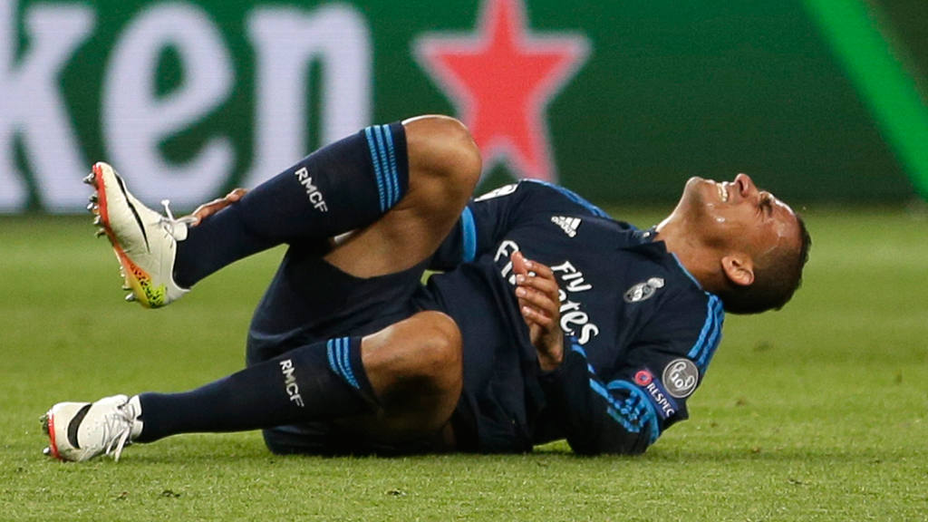 Real Madrid's Danilo grimaces in pain during the Champions League fir