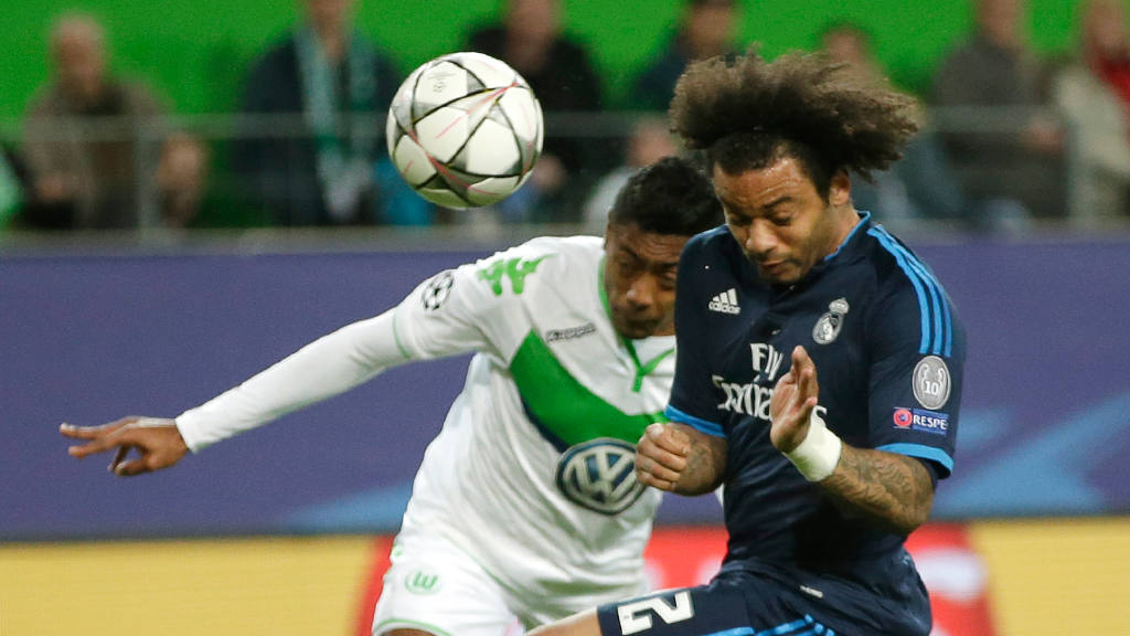 Wolfsburgøs Bruno Henrique heads a ball past Real Madrid's Marcelo