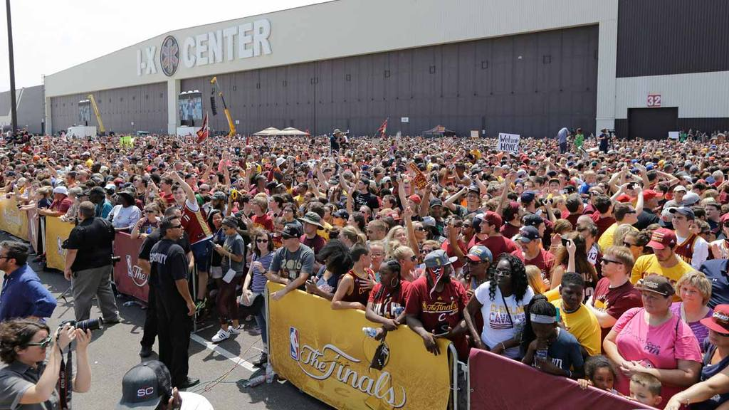 A large crowd of Cleveland Cavaliers fans wait for the arrival of the
