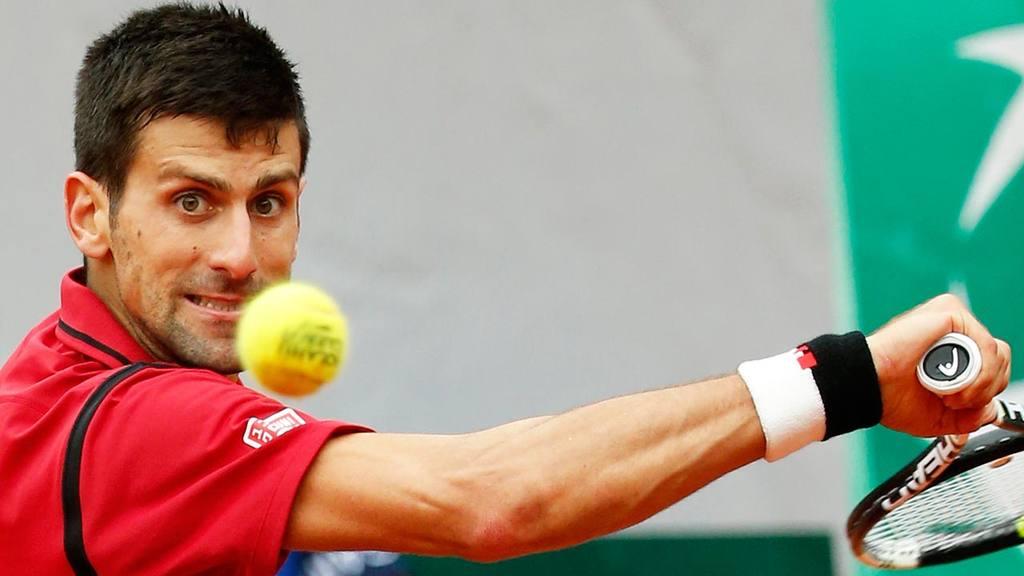 Serbia's Novak Djokovic returns the ball to Britain's Andy Murray dur