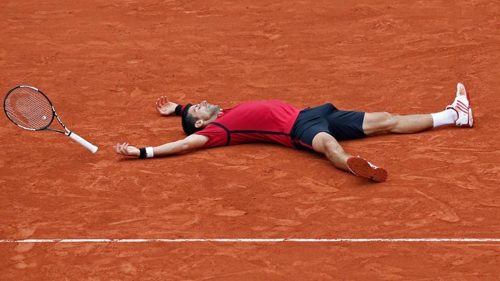 Serbia's Novak Djokovic celebrates winning the final of the French Op