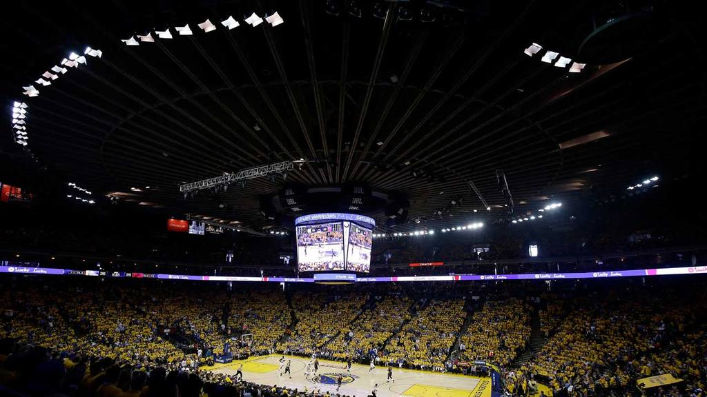 Fans at Oracle Arena watch during the first half of Game 1 of basketb