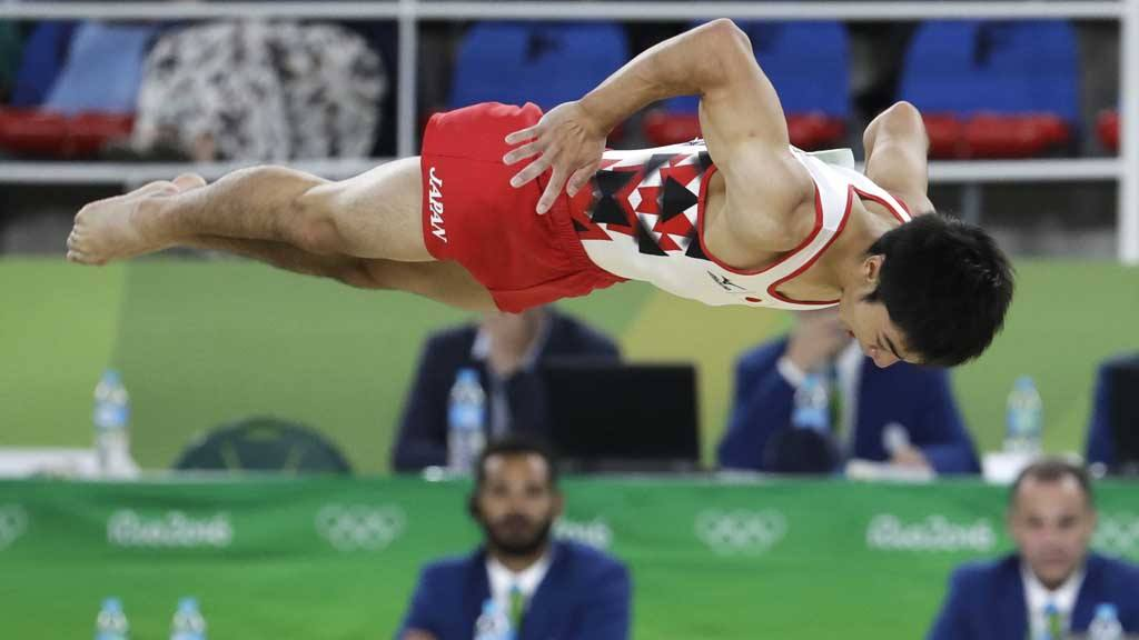 Japan's Kenzo Shirai performs on the floor during the artistic gymnas