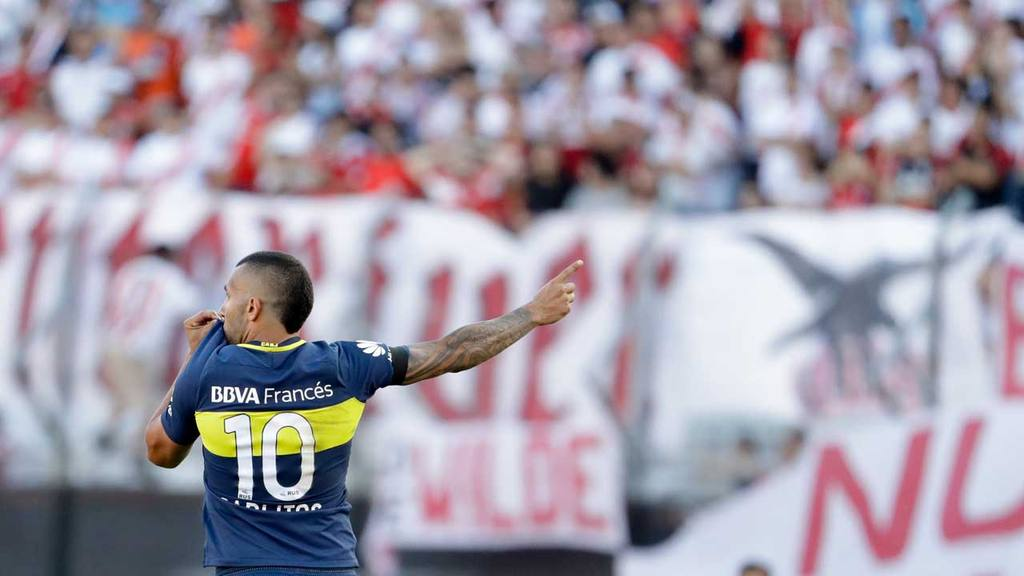 Boca Juniors' forward Carlos Tevez celebrates scoring against River P