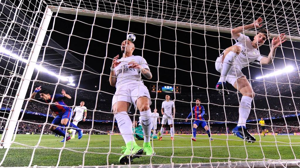 Barcelona's Uruguayan forward Luis Suarez (L) scores the opener past