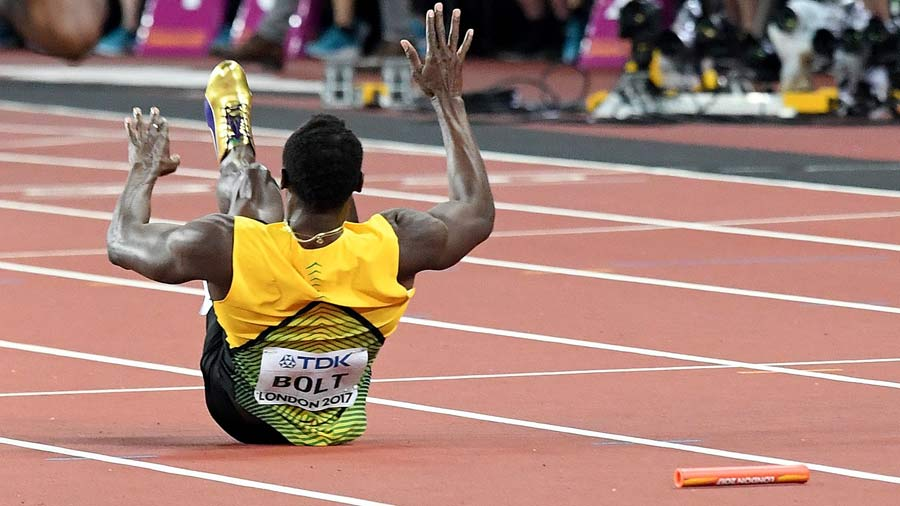 Jamaica's Usain Bolt lies on the track after pulling up injured in th