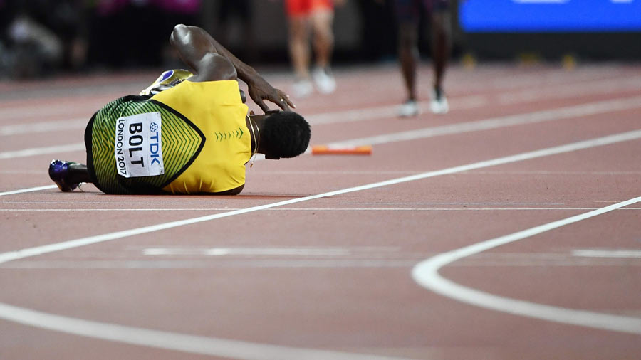 Jamaica's Usain Bolt goes down after pulling up injured in the final