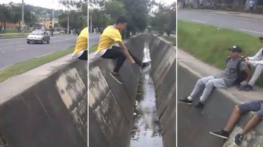 Joven intenta hacer acrobacia y cae en un canal de desagüe — Viral