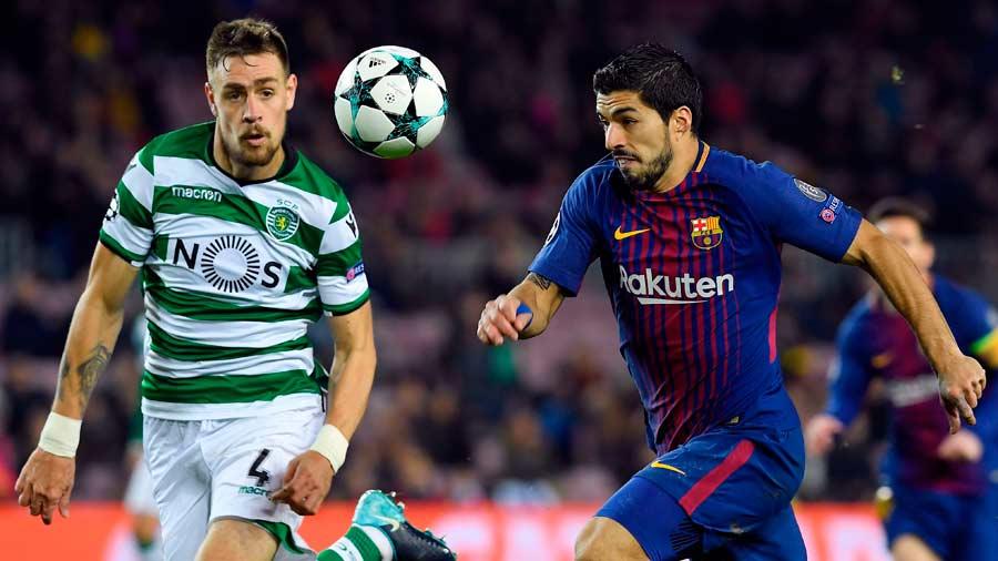 Sporting's Uruguayan defender Sebastien Coates challenges Barcelona's