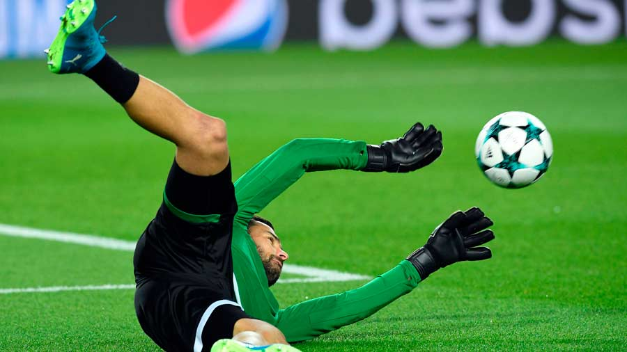 Sporting's Portuguese goalkeeper Rui Patricio warms up ahead of the U