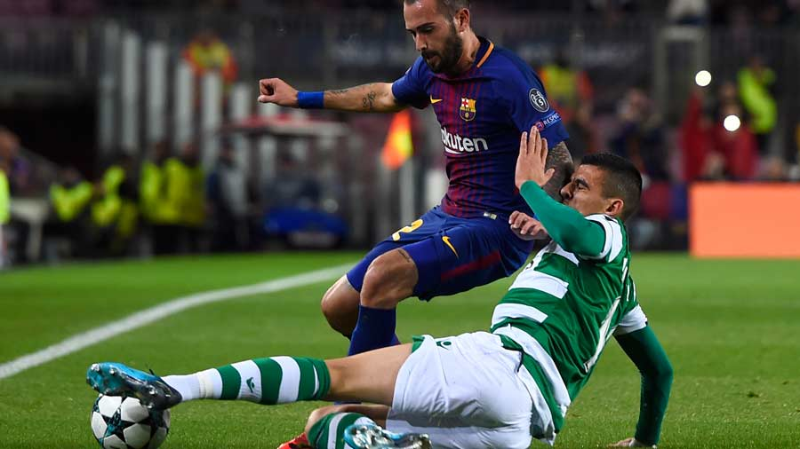 Barcelona's Spanish midfielder Aleix Vidal (back) challenges Sporting