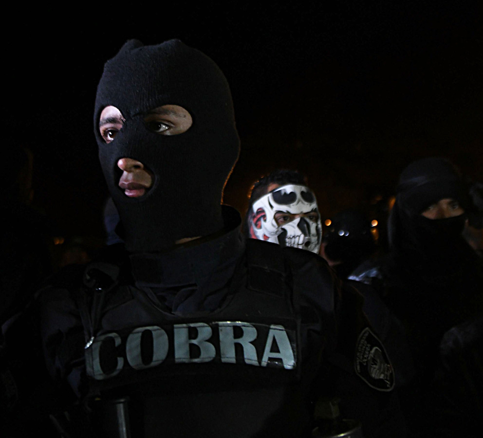 Police officers belonging to the COBRA Special Riot Command protest a