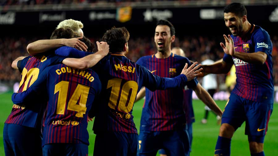 Barcelona players celebrate their opening goal during the Spanish 'Co