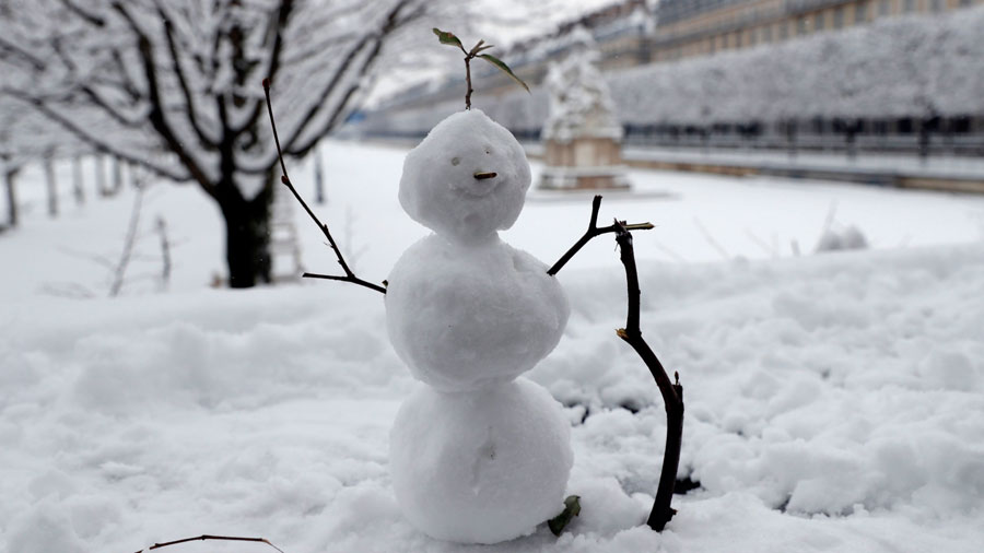TOPSHOT - A snow man is pictured in the Tuileries garden are pictured