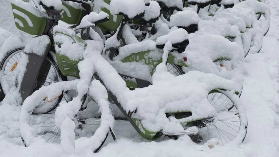 Snow covered bicycle are pictured on February 7