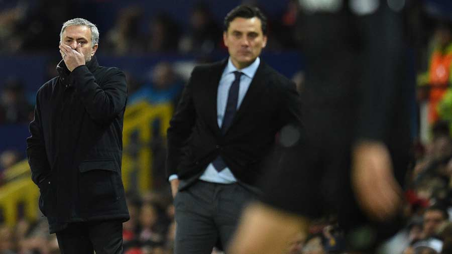 Manchester United's Portuguese manager Jose Mourinho (L) lookos on du