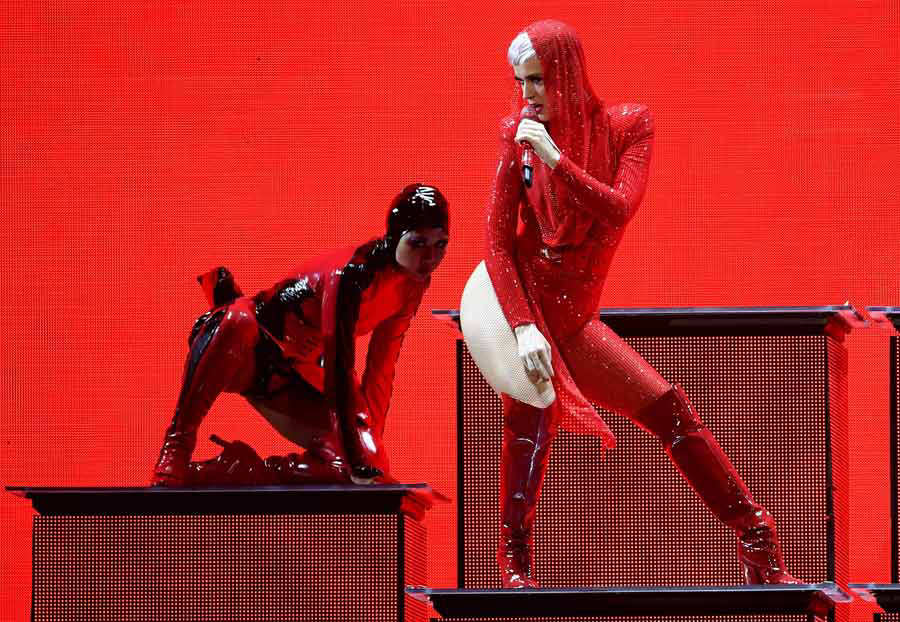 US singer and songwriter Katy Perry (R) performs on stage during a co
