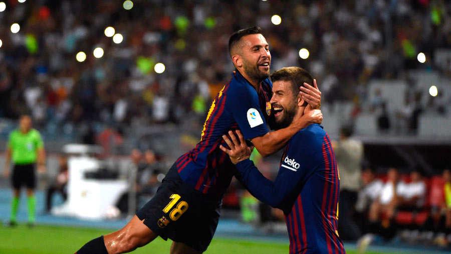 Barcelona's Spanish defender Gerard Pique celebrates after scoring a