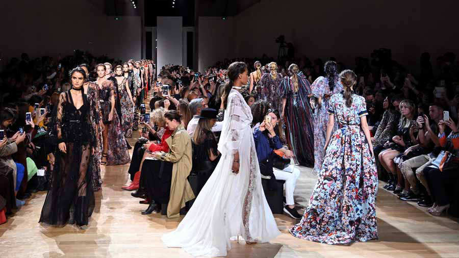 Models present creations by Elie Saab during the Spring-Summer 2019 R