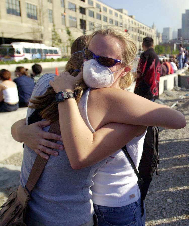 US-ATTACKS-RESIDENTS HUG
