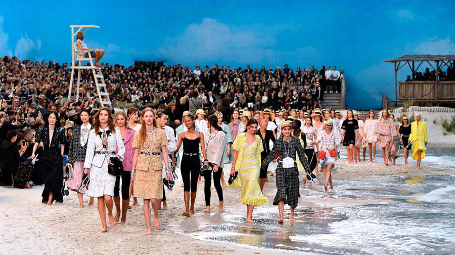 Models present creations by Chanel at the end of the Spring-Summer 20