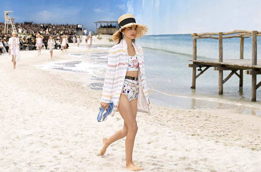 TOPSHOT - A model presents a creation by Chanel during the Spring-Sum