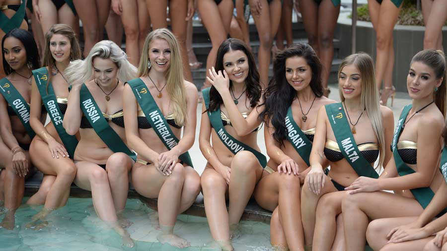 CORRECTION - Candidates to the Miss Earth beauty pageant pose for pho