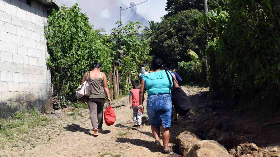 Residents of San Andres Osuna a community nearby the erupting Fuego v